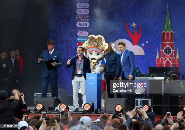 Ambassadors Aleksandr Kerzhakov and Marcel Desailly pose with the FIFA World Cup trophy along with mascot Zabivaka during the official opening of the...