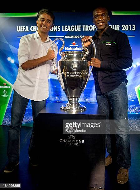 Ambassadors Bebeto and Clarence Seedorf pose with the UEFA Champions League trophy during the UEFA Champions League Trophy Tour 2013 at Casa Miranda...