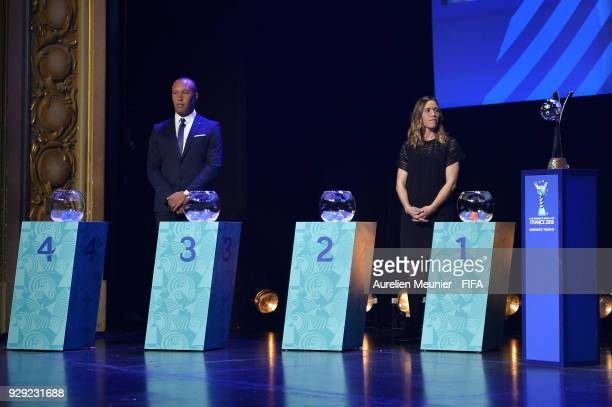 Ambassadors Camille Abily and Mikael Silvestre wait for the beginning of the official draw for the FIFA U20 Women's World Cup France 2018 on March 8...