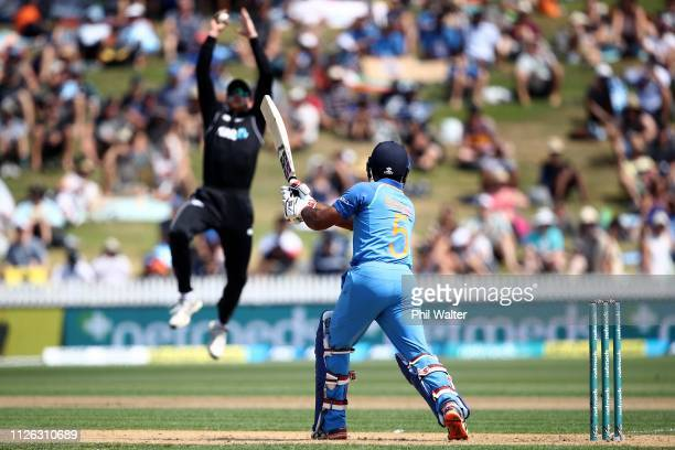 Ambati Rayudu of India is caught out by Martin Guptill of New Zealand during game four of the One Day International series between New Zealand and...