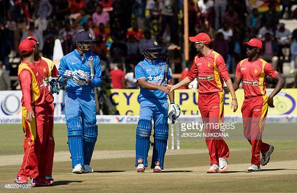Ambati Rayudu of India is congratulated by Zimbabwe players at the end of an innings win which he scored a century in the first One Day International...