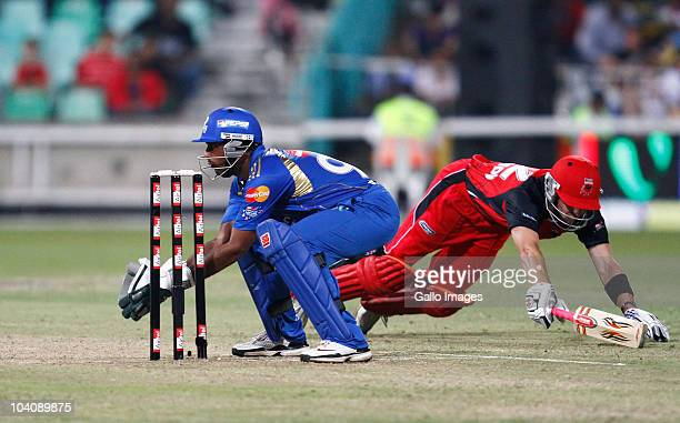 Ambati Rayudu of Mumbai Indians tries to run out Callum Ferguson of South Australian Redbacks during the Airtel Champions League Twenty20 match...