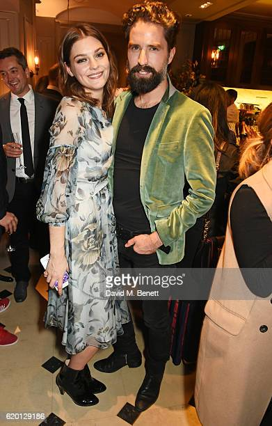 Amber Anderson and Jack Guinness wearing Burberry attend an event to celebrate 'The Tale of Thomas Burberry' at Burberry's all day cafe Thomas's on...
