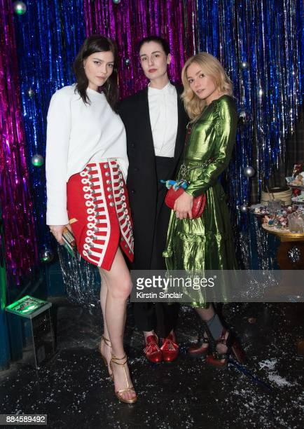 Amber Anderson Erin O'Connor and Clara Paget attends the Burberry x Cara Delevingne on December 2 2017 in London England