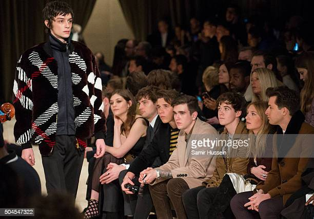 Amber Anderson Josh Whitehouse Brooklyn Beckham Gabriel DayLewis Alex Lawther Josephine de La Baume and Mark Ronson watch a model walk the runway at...