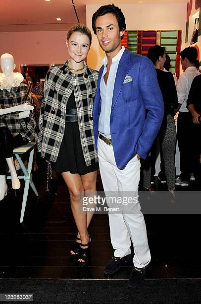 Amber Atherton and MarkFrancis Vandelli attend the opening of the Kate Spade New York store in Covent Garden on September 1 2011 in London England