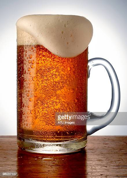 amber beer in glass - ラガービール ストックフォトと画像