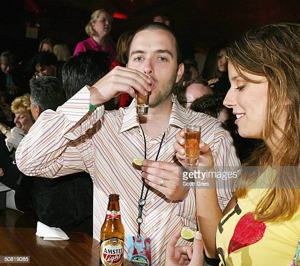 Amber Brkich has a drink with her brother at the Survivor Allstars/Reunion Show after party at Crobar May 9 2004 in New York City