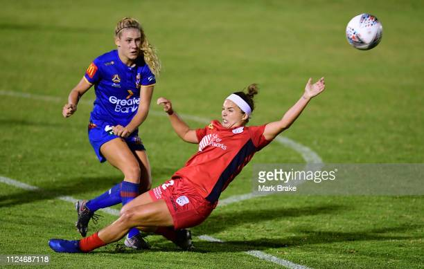 Amber Brooks of Adelaide United competes with Hannah Brewer of the Newcastle Jets during the round 13 WLeague match between Adelaide United and the...