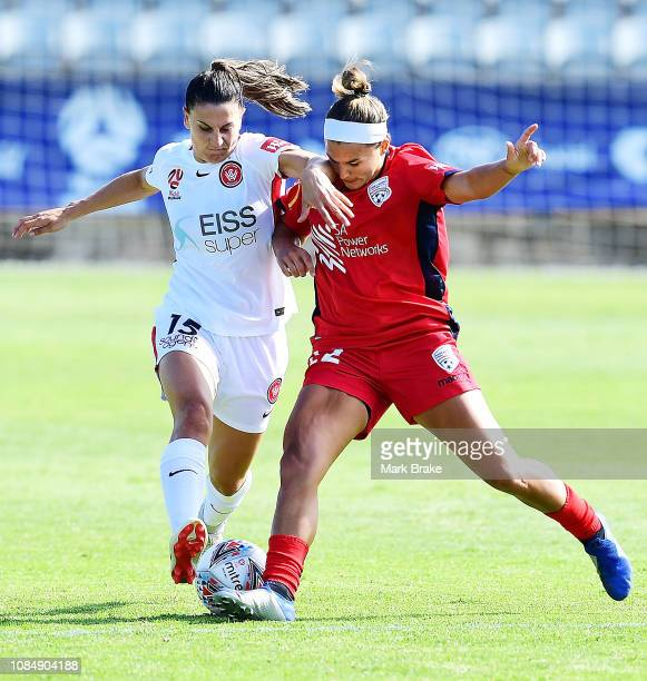Amber Brooks of Adelaide United takes out Talitha Kramer of the Wanderers during the round 12 WLeague match between Adelaide United and the Western...