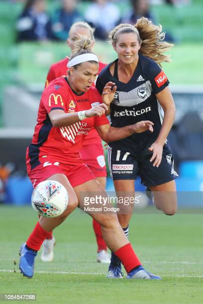 Amber Brooks of United competes for the ball against Danielle Weatherholt of the Victory during the round one WLeague match between Melbourne Victory...