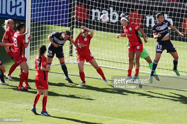Amber Brooks of United makes a save by heading the ball away during the round one WLeague match between Melbourne Victory and Adelaide United at AAMI...