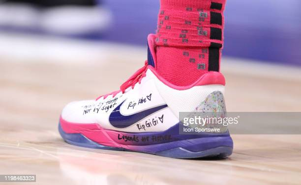 Amber Brown of the Pittsburgh Panthers wears the team breast cancer awareness shoes while also having a tribute to Kobe Bryant and his daughter, GiGi...