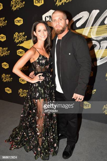 Amber Cochran and Brantley Gilbert attend the 2018 CMT Music Awards at Nashville Municipal Auditorium on June 6 2018 in Nashville Tennessee