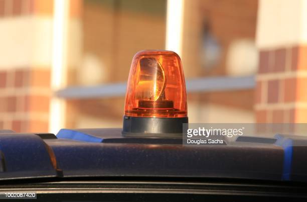 Amber colored overhead flashing strobe light