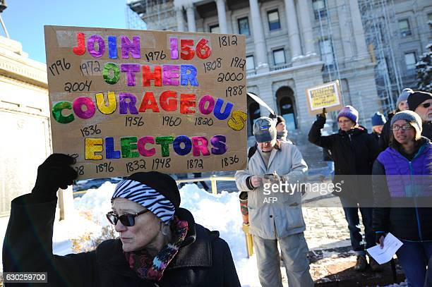 Amber Dahlin holds a sign urging the electors to vote their conscience outside the Colorado Capitol building in Denver Colorado on December 19 2016...
