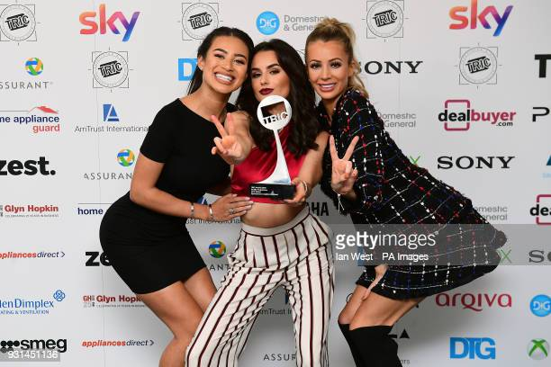 Amber Davies Montana Brown and Olivia Attwood with the Reality Programme Award for Love Island during the 2018 TRIC Awards at the Grosvenor House...