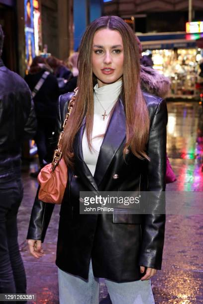 """Amber Davis attends the """"A Christmas Carol"""" opening night at the Dominion Theatre on December 14, 2020 in London, England."""