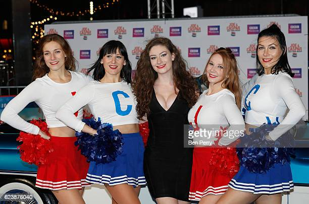 Amber DoigThorne accompanied by cheerleaders attends the UK Premiere of Joe Casper Hit The Road USA at Cineworld Leicester Square on November 17 2016...