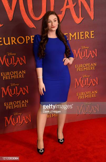"""Amber Doig-Thorne attends the """"Mulan"""" photocall at Trafalgar Hotel on March 13, 2020 in London, England."""