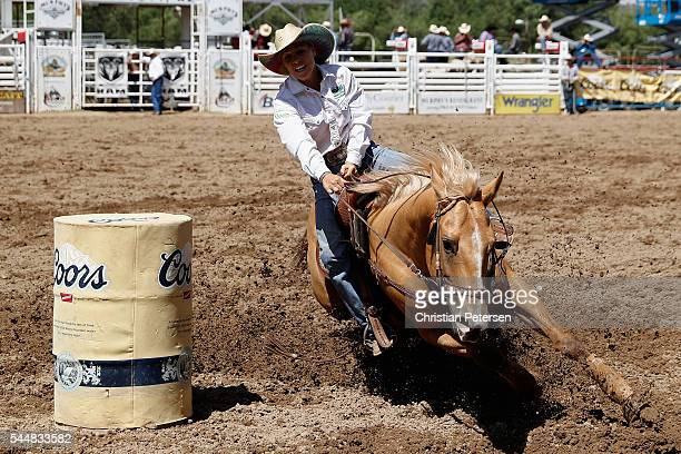 Amber Egger of Surprise AZ competes in the women's barrel racing at the Prescott Frontier Days World's Oldest Rodeo on July 2 2016 in Prescott Arizona