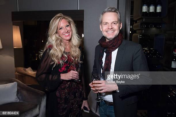 Amber Estabrook and Paul Robertson attend GQ Celebrates Milan Men's Fashion Week during Milan Men's Fashion Week Fall/Winter 2017/18 on January 15...