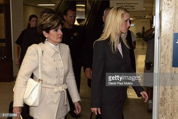 Amber Frey and her lawyer Gloria Allred leave the San Mateo County Court House after her testimony during the ongoing trial of Scott Peterson August...