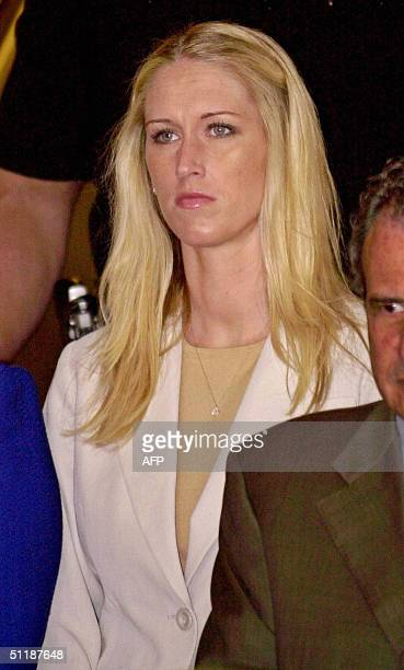 Amber Frey former mistress of Scott Peterson leaves the San Mateo Superior County Courthouse after a delay in the Scott Peterson trial August 18 2004...