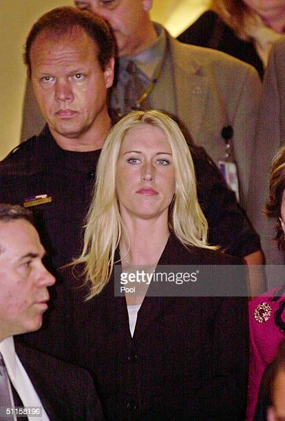 Amber Frey leaves a Redwood City California courtroom after testifying at the Scott Peterson trial August 10 2004 in Redwood City California Scott...