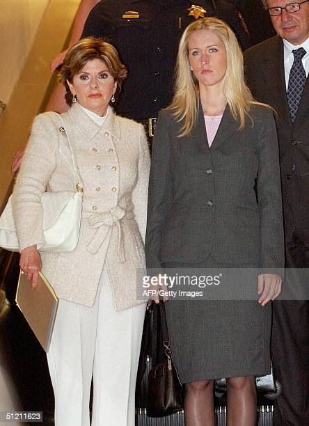 Amber Frey leaves the courthouse with her attorney Gloria Allred after she was questioned by attorney Mark Geragos during the Scott Peterson trial at...