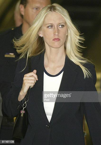 Amber Frey leaves the San Mateo County Courthouse after her second day of testimony in the Scott Peterson double murder trial on August 11 2004 in...