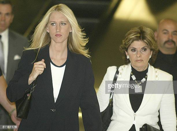 Amber Frey leaves the San Mateo County Courthouse flanked by her lawyer Gloria Allred after Frey's second day of testimony in the Scott Peterson...