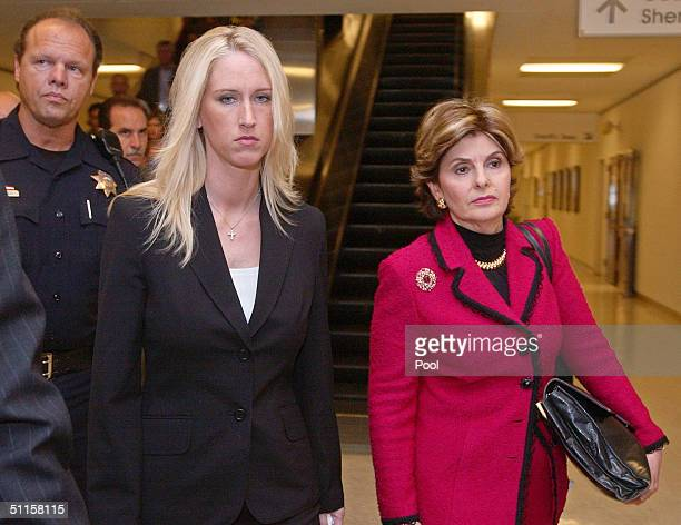 Amber Frey leaves with her attorney Gloria Allred after she testified at the Scott Peterson trial August 10 2004 in Redwood City California Peterson...