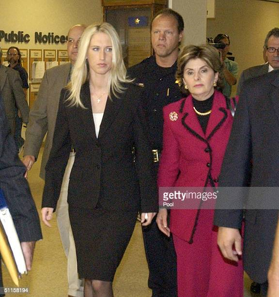 Amber Frey mistress of murder suspect Scott Peterson walks with attorney Gloria Allred as they leave the San Mateo County Superior Court August 10...