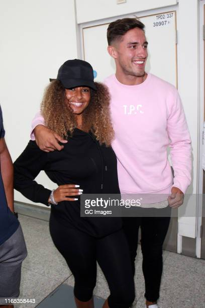 Amber Gill and Greg O'Shea seen arriving at London Stansted airport on Wednesday after jetting back from Mallorca on July 31 2019 in London England