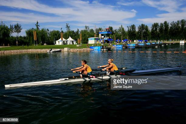 Amber Halliday and Marguerite Houston of Australia row to the start of the Women's Doubles Sculling at the Shunyi Olympic RowingCanoeing Park during...