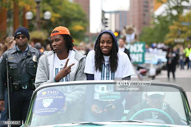 Amber Harris and Devereaux Peters of the 2013 WNBA Champion Minnesota Lynx ride in the Championship Parade through downtown Minneapolis at Target...