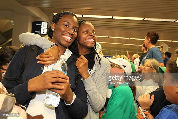 Amber Harris and Jessica Adair of the 2011 WNBA Champions Minnesota Lynx enjoy the welcome by fans on October 8 2011 at MinneapolisSt Paul...