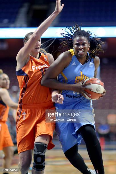 Amber Harris of the Chicago Sky drives to the basket defended by Jennifer Hanson of the Connecticut Sun during the Connecticut Sun Vs Chicago Sky...