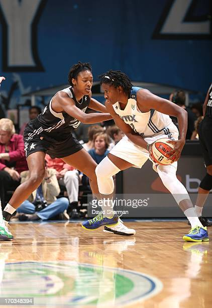 Amber Harris of the Minnesota Lynx attempts to drive to the basket against Kayla Alexander of the San Antonio Silver Stars during the WNBA game on...