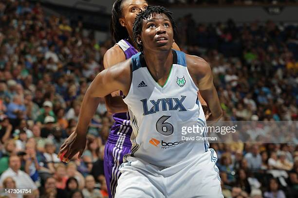Amber Harris of the Minnesota Lynx boxes out DeWanna Bonner of the Phoenix Mercury during the game on June 27 2012 at Target Center in Minneapolis...