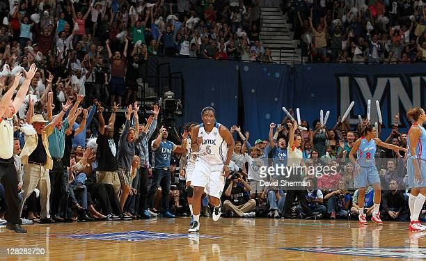 Amber Harris of the Minnesota Lynx celebrates after her first career 3 point basket during the game against the Atlanta Dream in Game Two of the 2011...