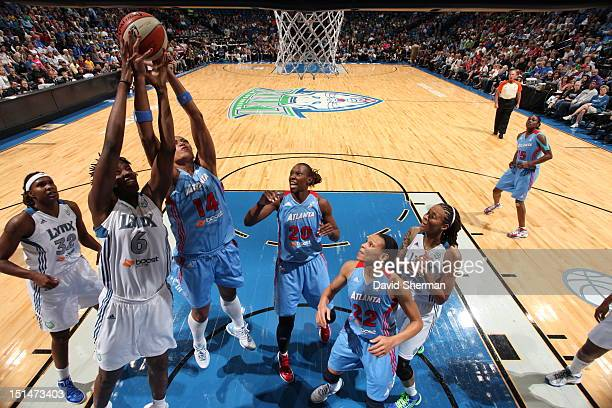 Amber Harris of the Minnesota Lynx fights for the rebound against Erika de Souza of the Atlanta Dream during the WNBA game on September 7 2012 at...