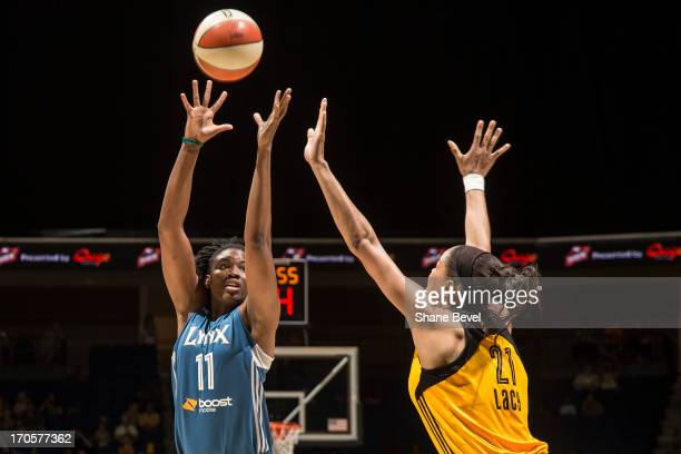 Amber Harris of the Minnesota Lynx fires a shot over the top of Jennifer Lacy of the Tulsa Shock during the WNBA game on June 14 2013 at the BOK...