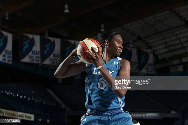 Amber Harris of the Minnesota Lynx grabs a rebound during the WNBA game against the Chicago Sky on August 12 2011 at the AllState Arena in Rosemont...