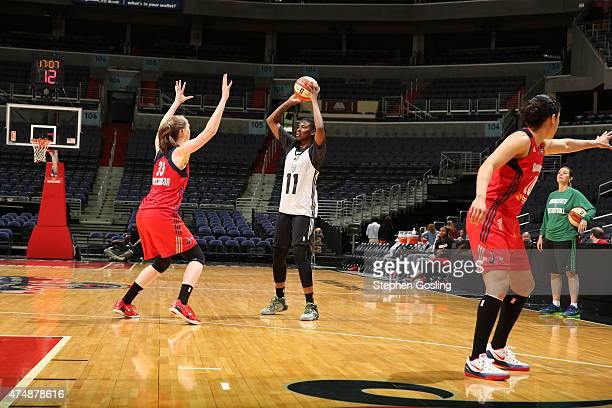 Amber Harris of the Minnesota Lynx handles the ball against the Washington Mystics during an Analytic Scrimmage at the Verizon Center on May 26 2015...