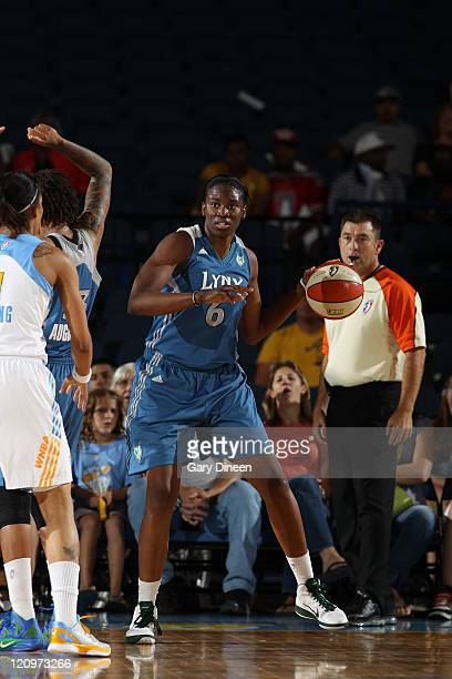 Amber Harris of the Minnesota Lynx looks to pass while guarded by Tamera Young of the Chicago Sky during the WNBA game on August 12 2011 at the...