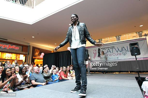 Amber Harris of the Minnesota Lynx participates in Catwalk for a Cure fashion show fundraiser to benefit the Lynx Foundation to raise money for...