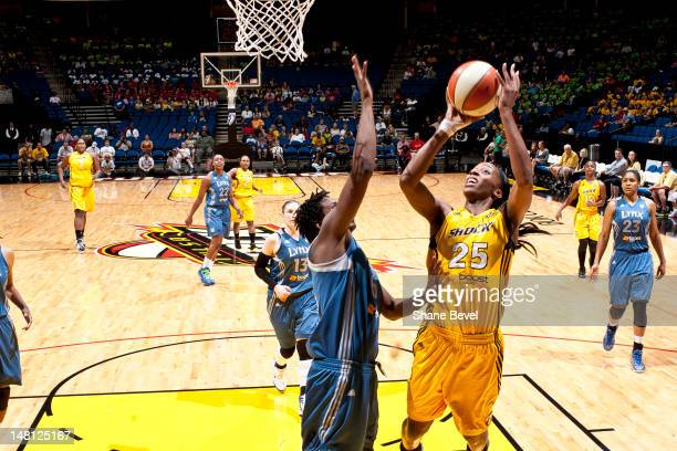 Amber Harris of the Minnesota Lynx plays defense against Glory Johnson of the Tulsa Shock during the WNBA game on July 10 2012 at the BOK Center in...