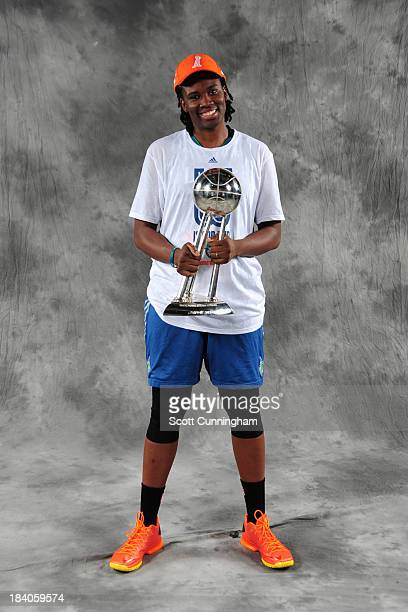 Amber Harris of the Minnesota Lynx poses for a picture with the trophy after winning Game 3 of the 2013 WNBA Finals at Gwinnett Arena on October 10...